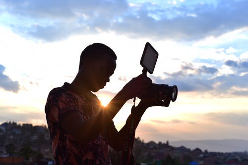 Person Holding Camera