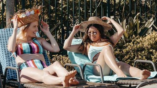 Women Relaxing on Sun Loungers