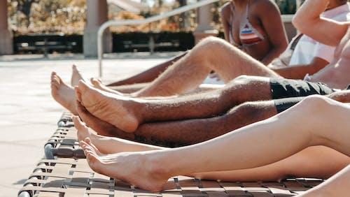People's Legs on Sun Loungers