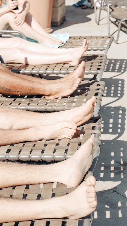 People's Feet on Sun Loungers