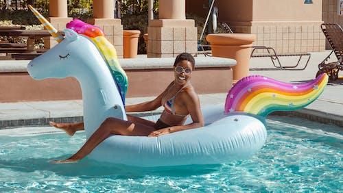 Woman in Pink Bikini on Swimming Pool