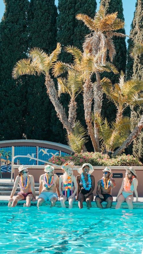 People Sitting on the Poolside