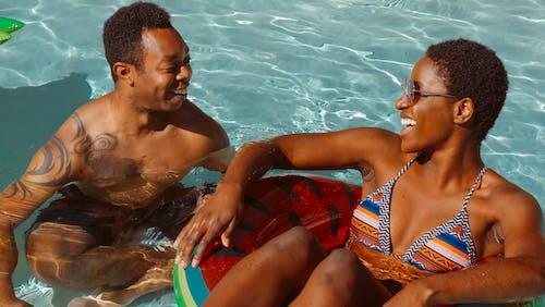Man and Woman Having Fun in the Swimming Pool