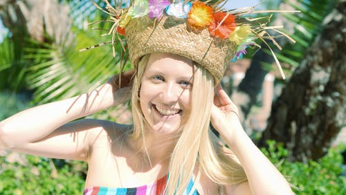 Woman Smiling while Wearing a Headdress