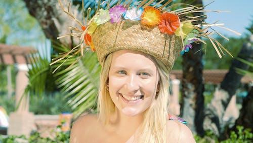 Smiling Woman Wearing a Headdress