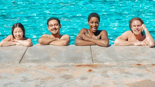 People Smiling in the Swimming Pool