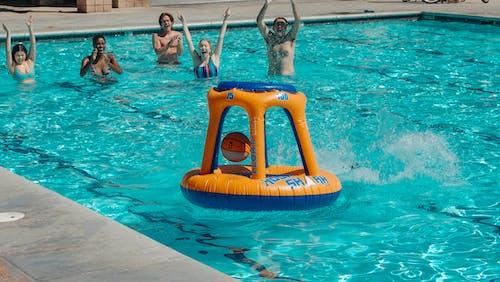 People Having Fun in the Swimming Pool