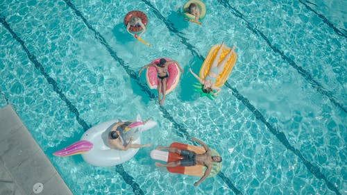 Top View of People Swimming in the Pool