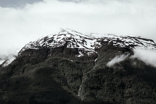 Grayscale Photo of Snowcapped Mountain