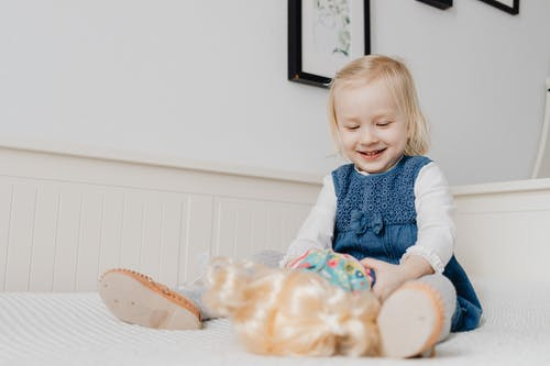 Close-Up Photo of a Cute Kid Playing with a Toy
