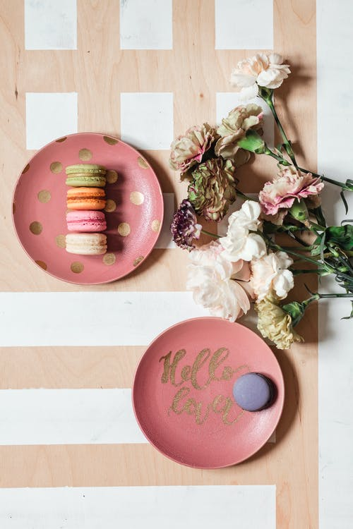 Pink and Brown Round Cake on White Wooden Table