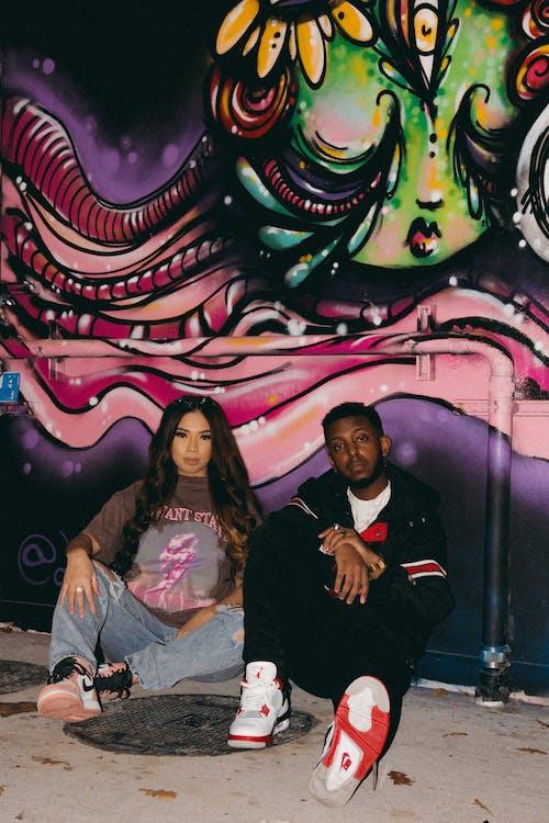 Man in Black Jacket Sitting Beside Woman in Gray Jacket