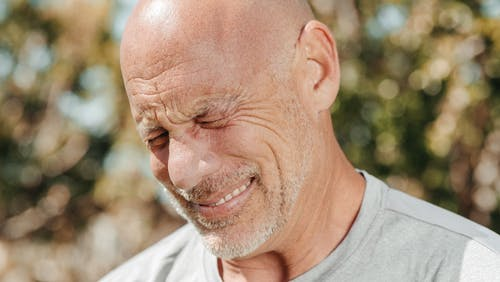 A Close-Up Shot of a Bearded Man