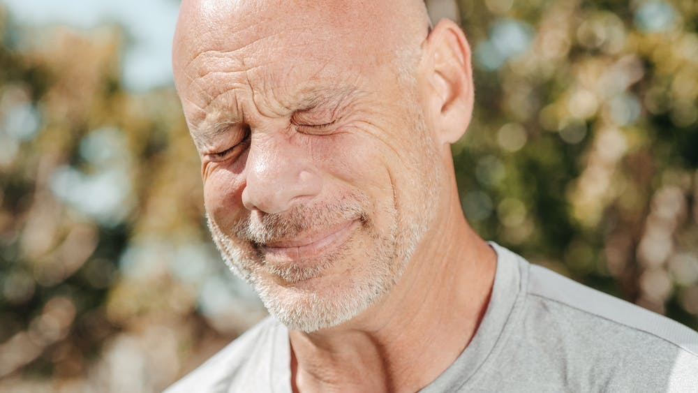 An old man who is feeling unwell.   Photo: Pexels