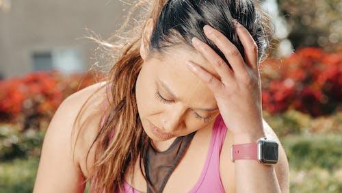 Close Up Photo of Woman Having Migraine