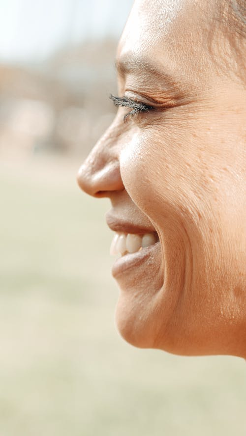 Side Profile on Smiling Woman