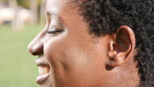 Close Up Photo of Person Smiling