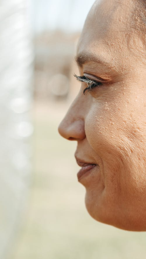 Close Up Photo of Person's Side Profile