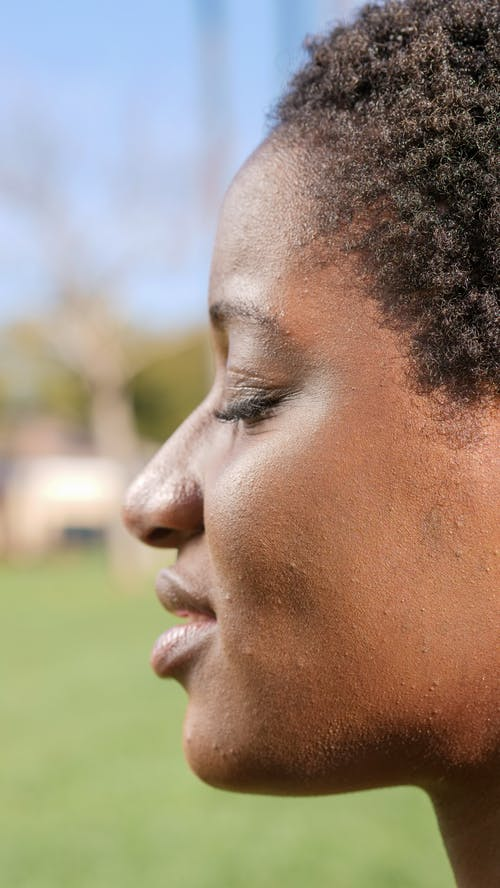 Close Up Photo of Woman's Side Profile
