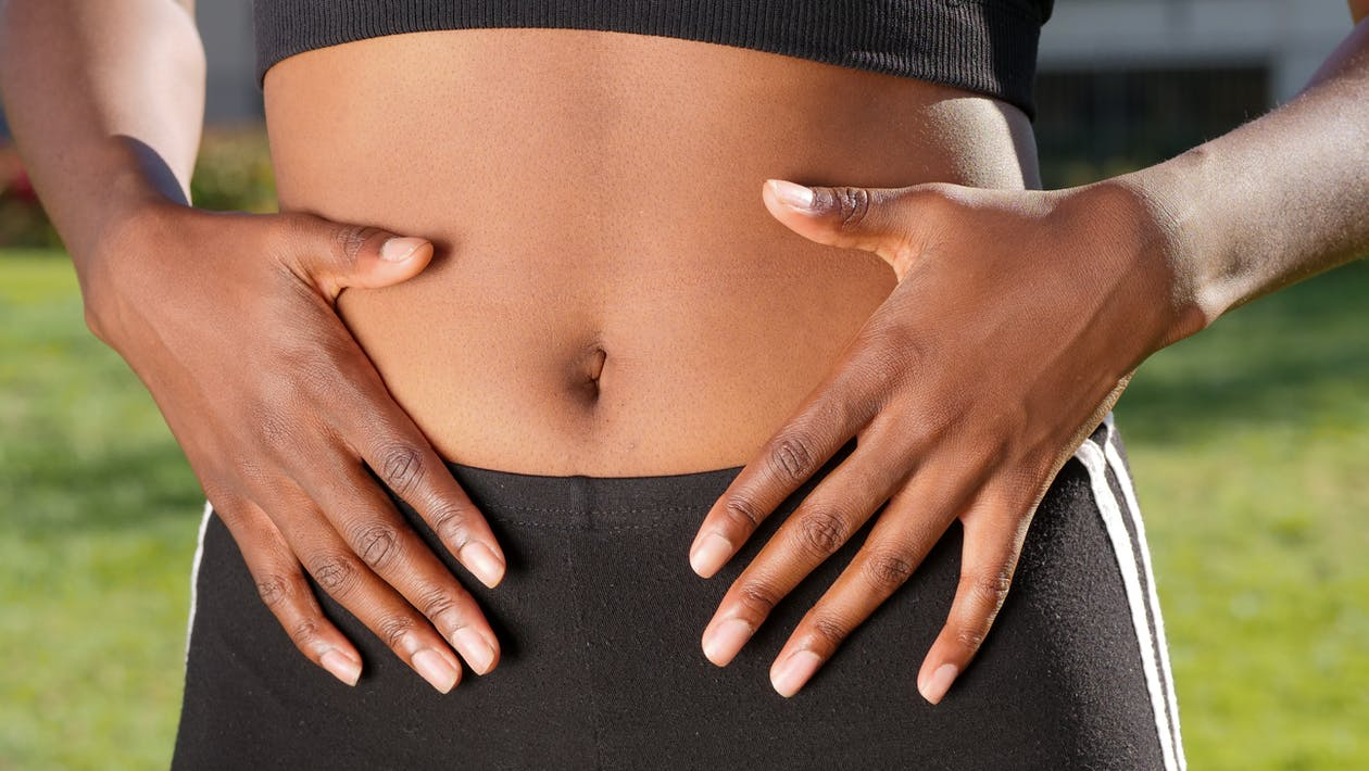 A Person Touching Her Belly