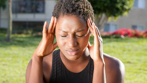 Woman in Pain due to Headache