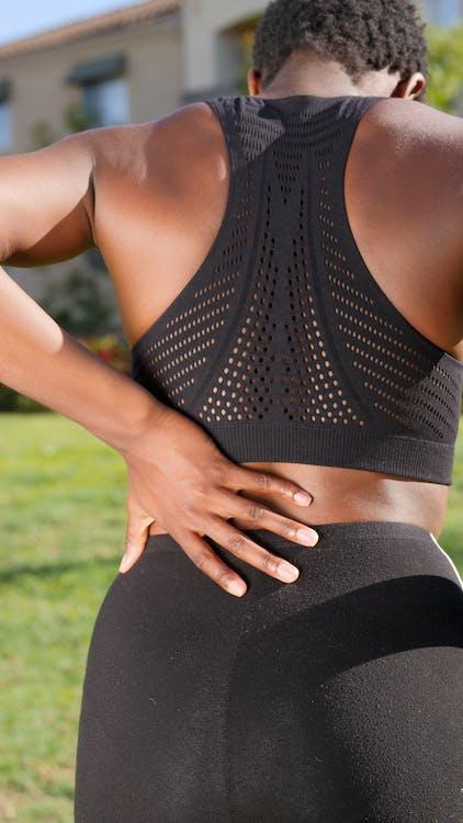 A Woman Having a Back Pain