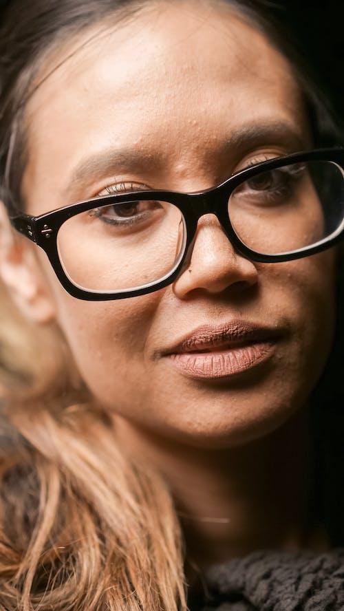 Close Up Photo of Woman Wearing Black Framed Eyeglasses