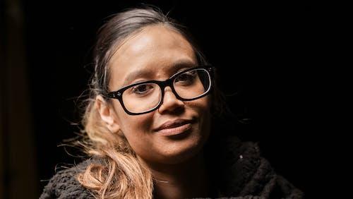 Portrait Photo of Woman Wearing Black Framed Eyeglasses
