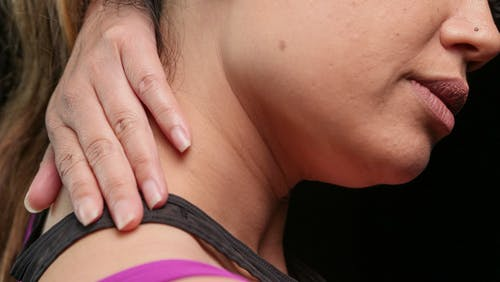 Close-Up Photo of a Woman Having a Neck Pain