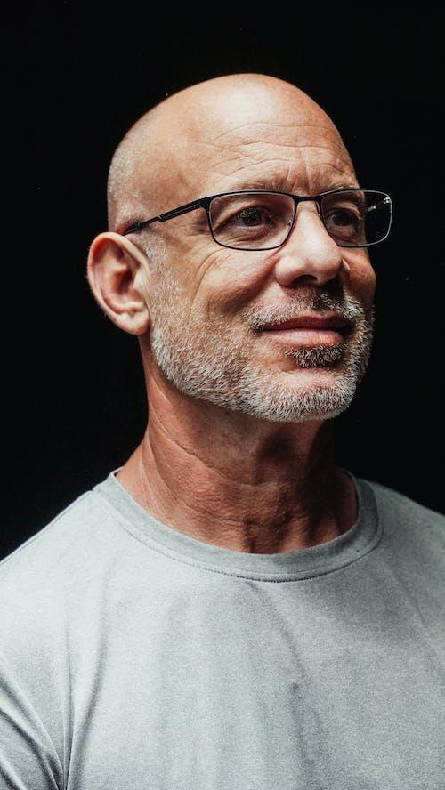 Man in Gray Crew Neck Shirt Wearing Black Framed Eyeglasses