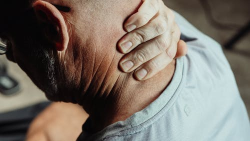 Close-Up Photo of a Man Having a Neck Pain