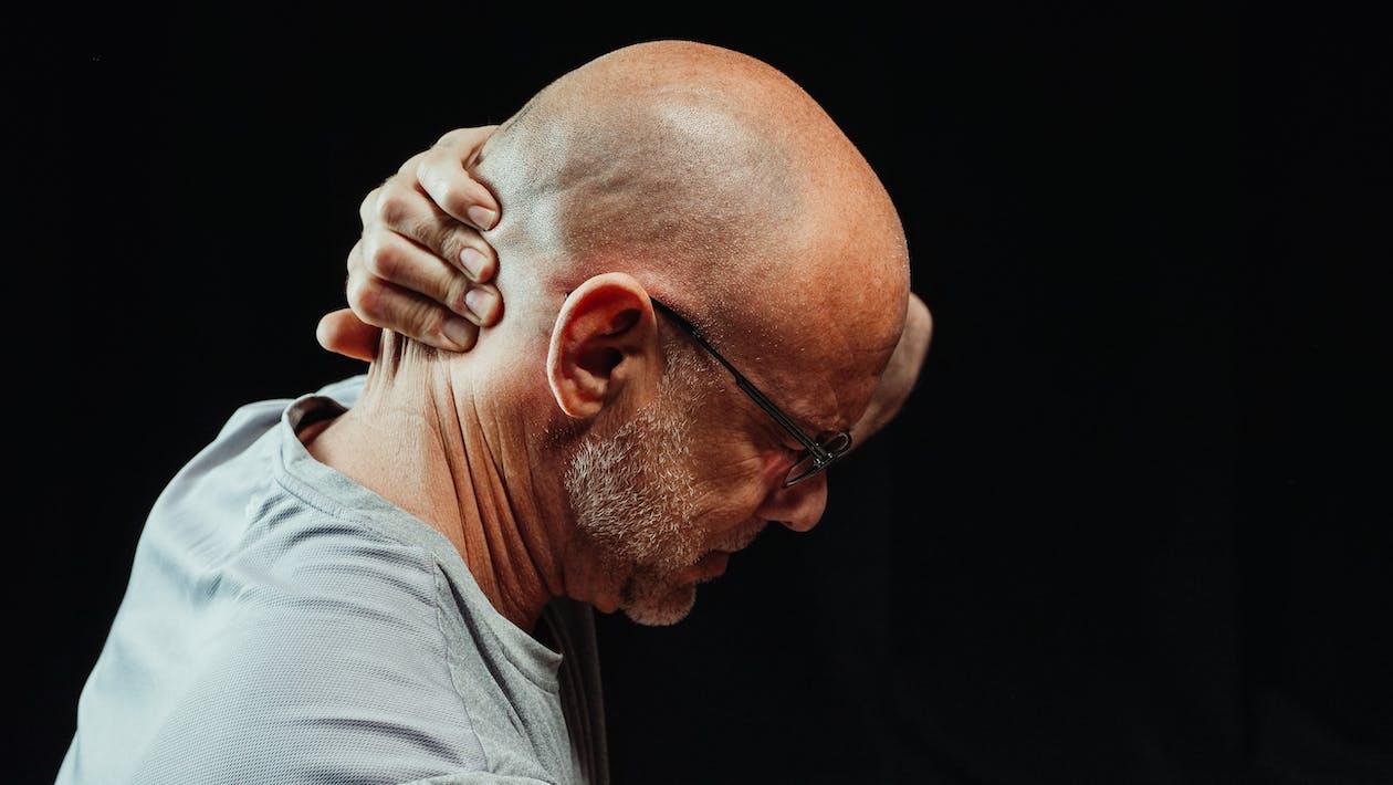 Close-Up Photo of Man Having a Neck Pain