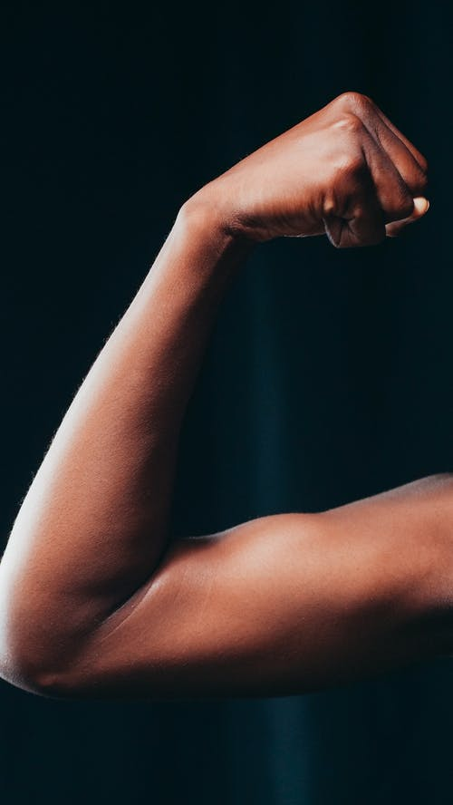 A Person Flexing Her Biceps