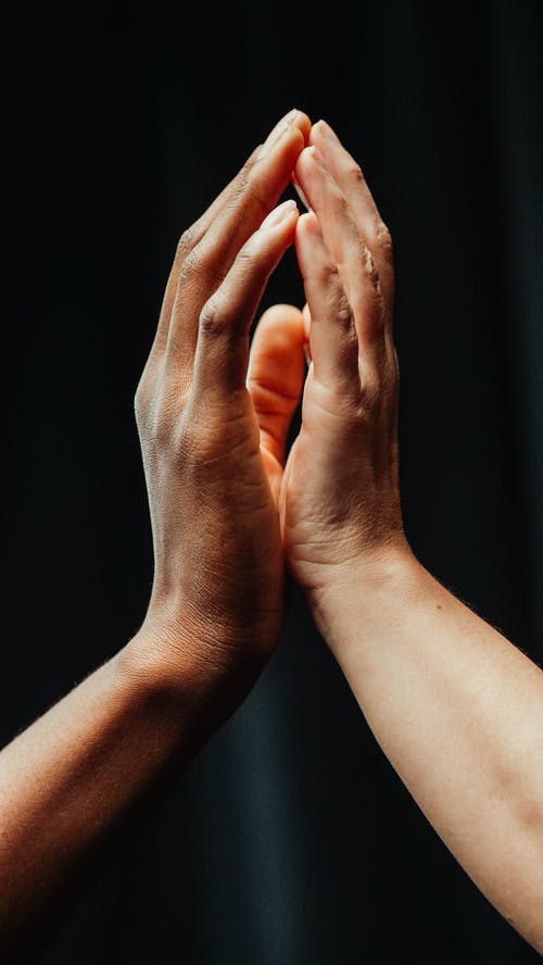 Close-Up of Two People Touching Each Other's Hands