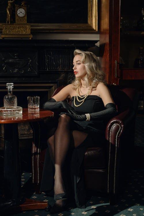 Photo of an Elegant Woman Wearing Black dress
