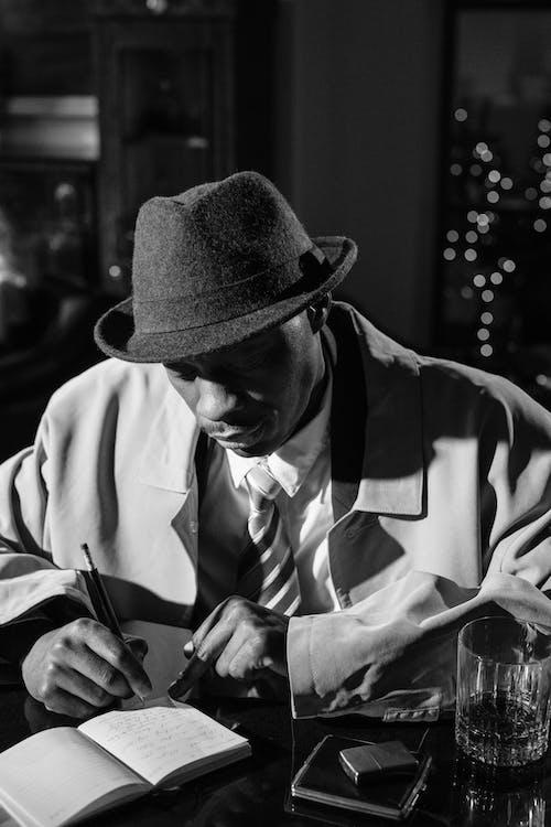 Photo of Man Taking Notes