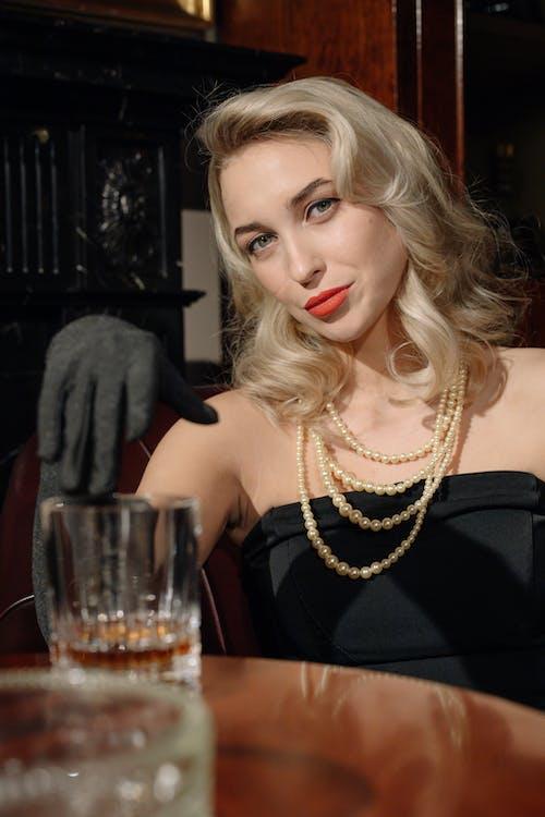 Photo of an Elegant Woman Wearing Off-Shoulder Dress