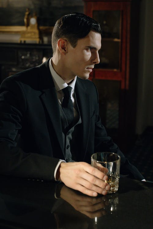 Photo of Man Holding Glass of Liqour