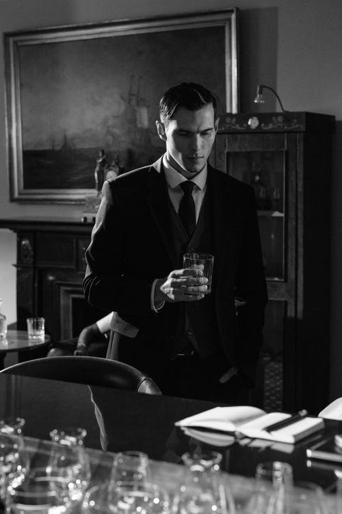 Photo of Handsome Man Holding Glass of Whiskey
