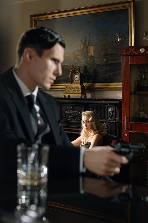 Photo of an Elegant Woman Looking at Man