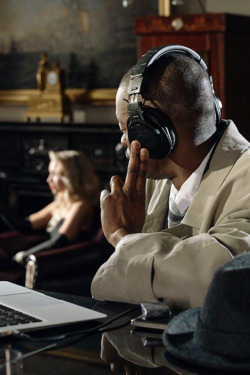 Photo of Man Using Black Headphones