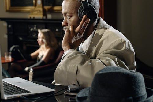 Photo of Man Listening to Black Headphones