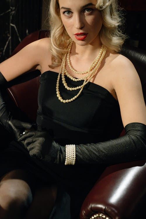Photo of an Elegant Woman Wearing Black Tube Dress