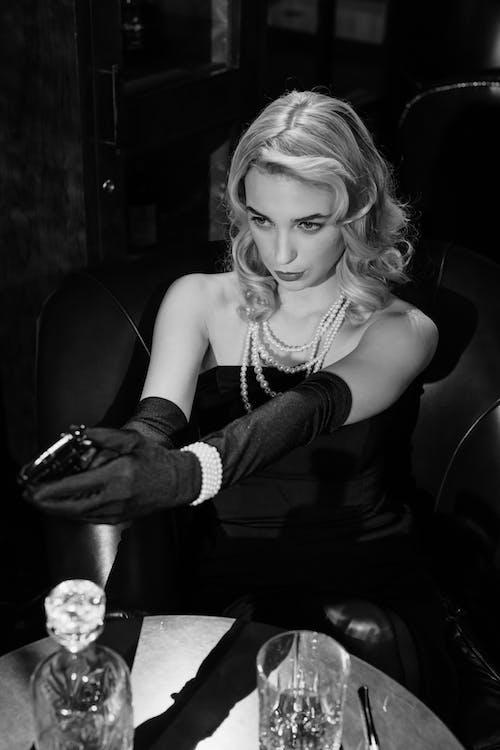 Photo of an Elegant Woman Pointing the Gun