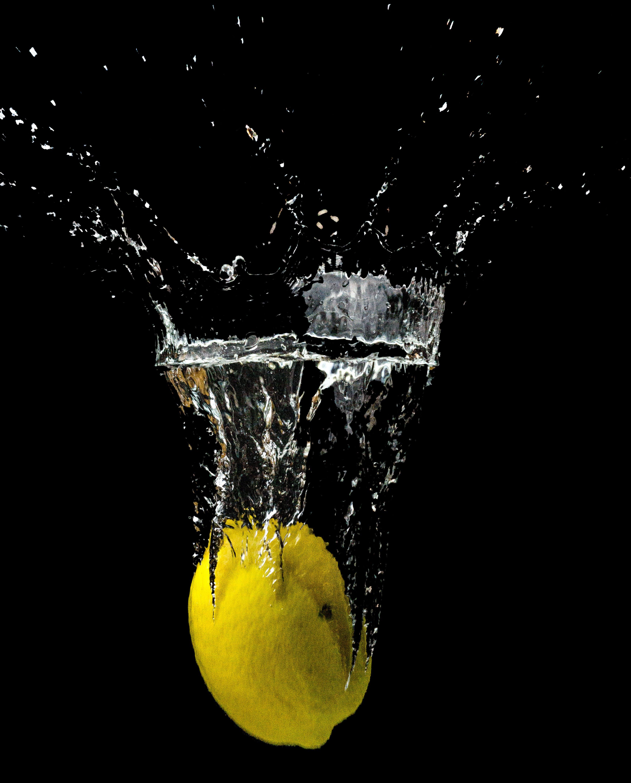 Yellow Lemon Submerged in Water