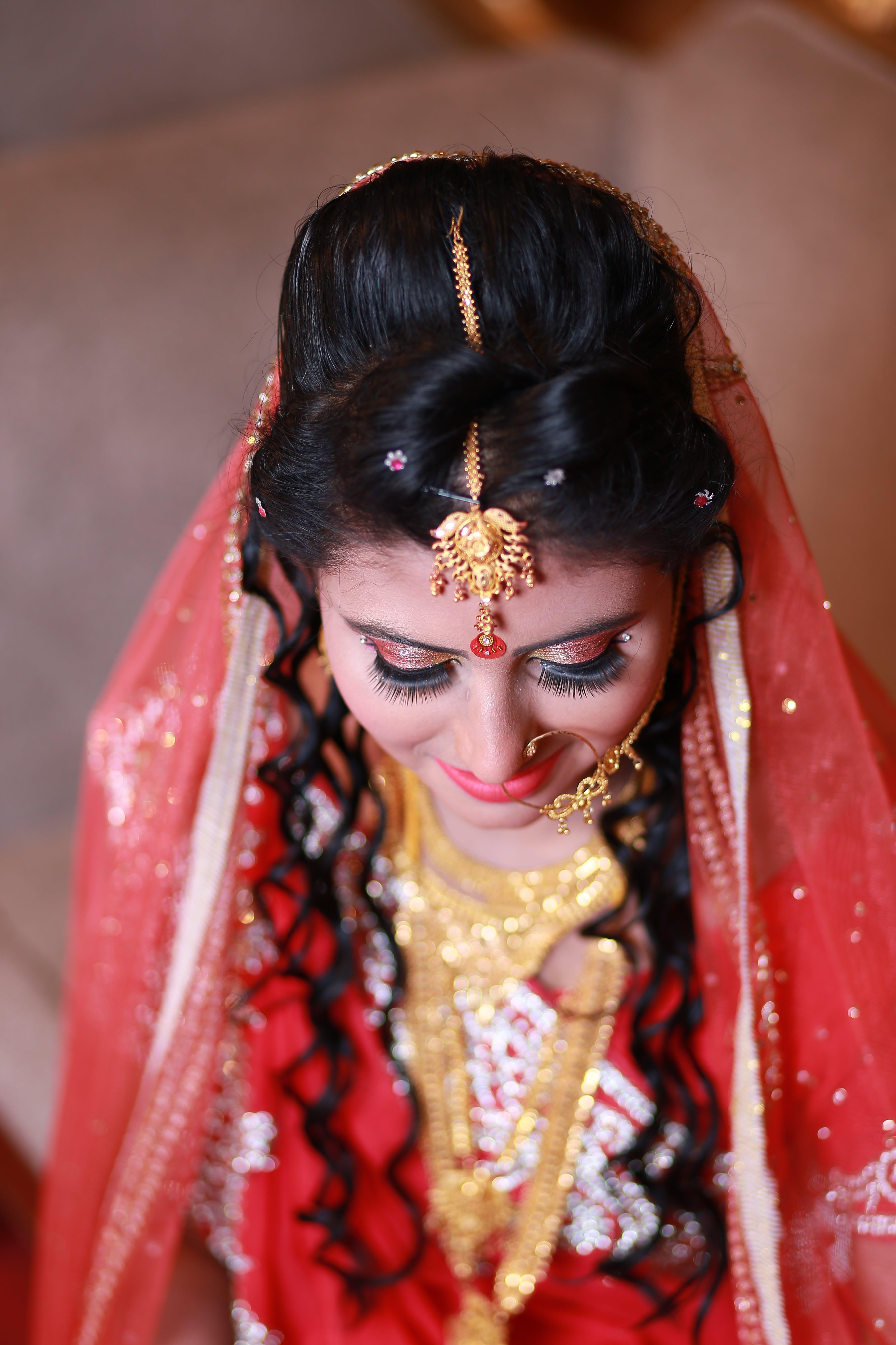 Woman Wearing Red and White Sari