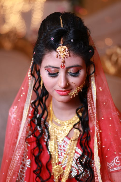 Selective Focus Photography of Woman Wearing Traditional Dress With Gold-colored Accessories