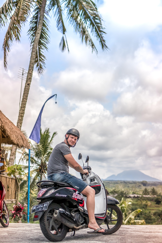 Man Riding Motor Scooter