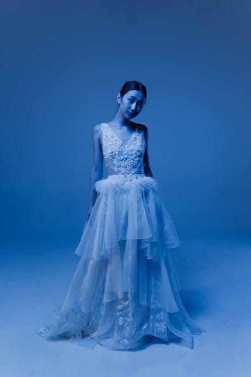 A Woman in White Sleeveless Long Dress