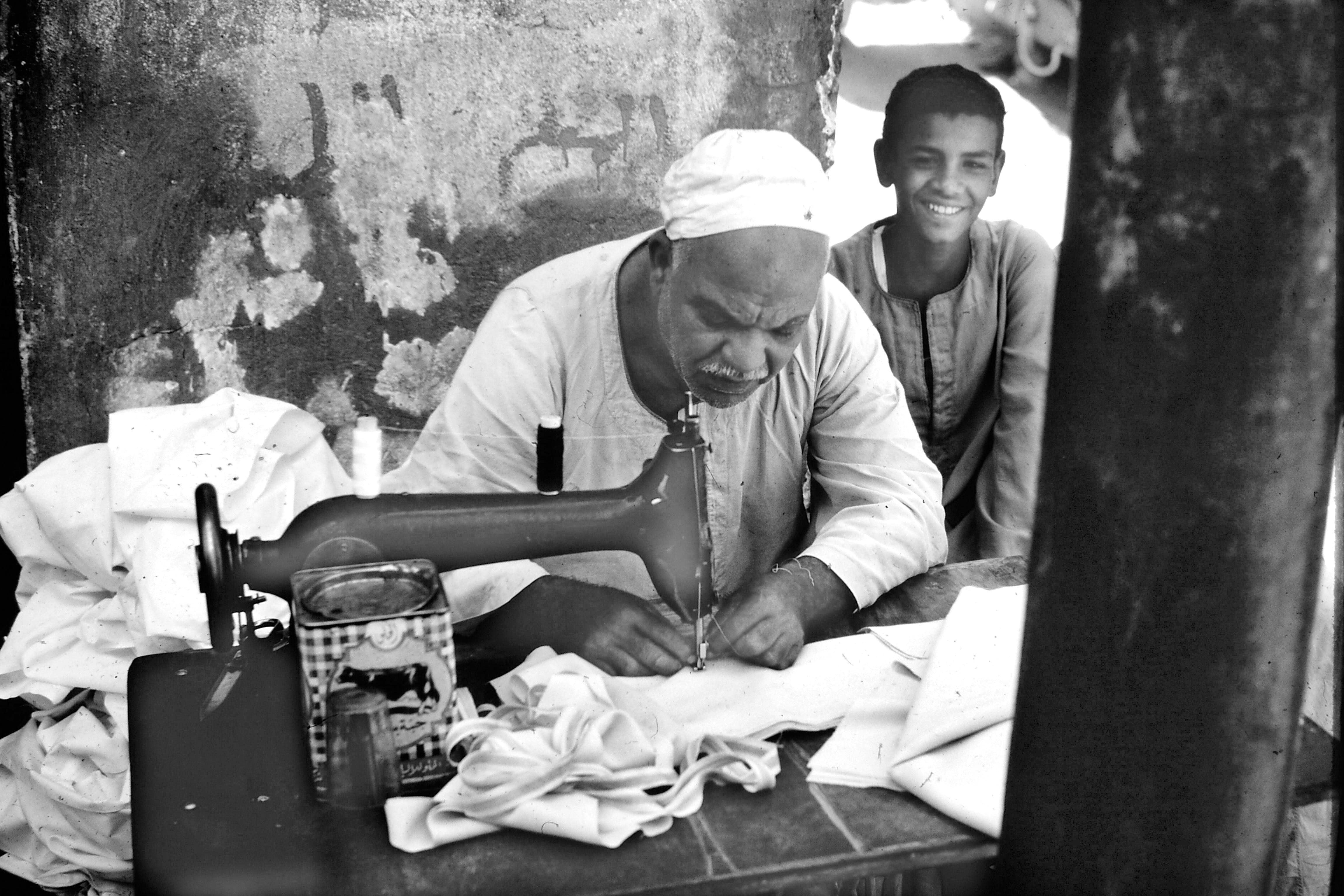 Person Sewing Cloth on Sewing Machine